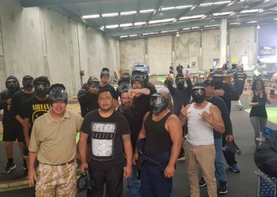 A group of people inside a paintball area